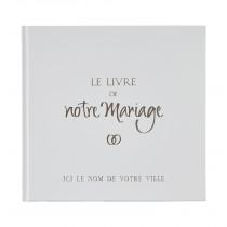 Le Livre de Notre Mariage avec sa couverture blanche
